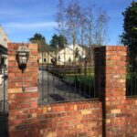 salvaged red brick piers & gate